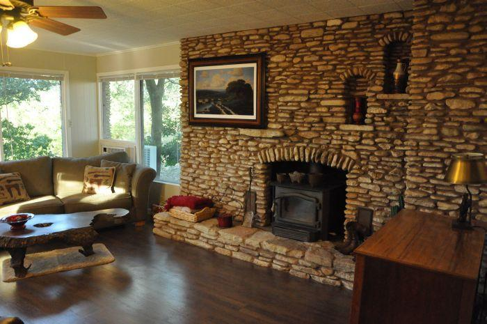 Hand laid river rock fireplace with stove insert.  Unlimited firewood provided! - Be Inspired in This Light Filled Artist's Studio! - Georgetown - rentals