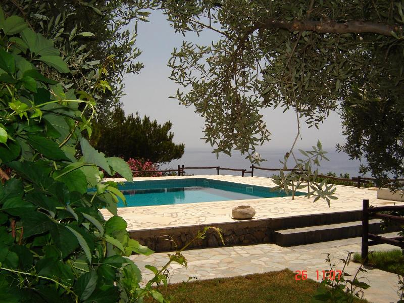 Swimming pool with sea view and pine trees for natural shade.Sunbeds are provided.