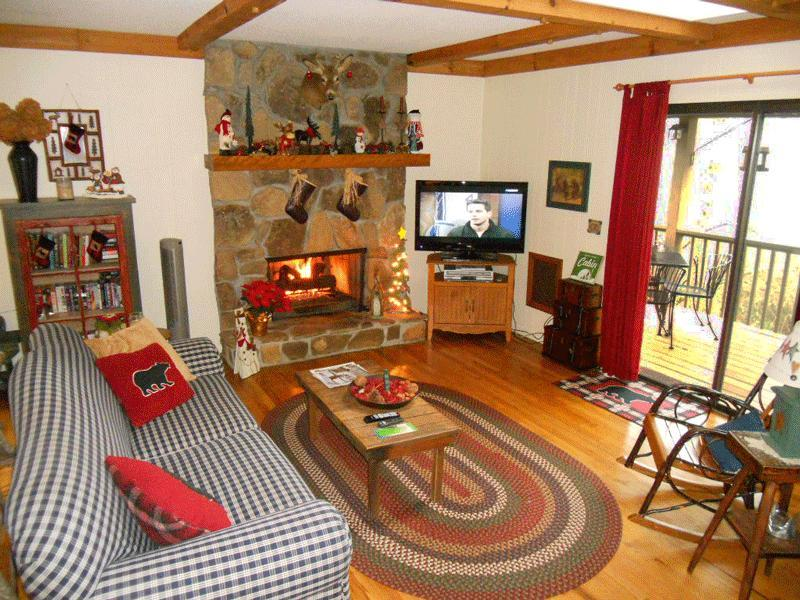 Family Room with Stone Fireplace, LCD Flat Screen TV, Cable, Books, Videos, DVD's & Games.
