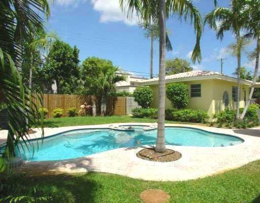 View of beautiful, private yard with lush landscaping, pool & spa