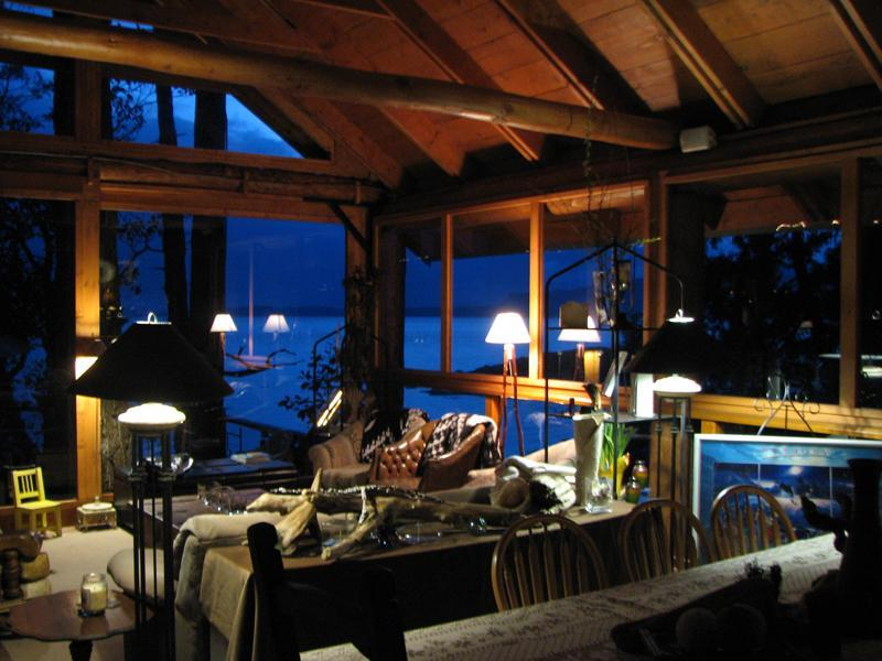 Inside the living room in the Longhouse, this is an outdoor post & beam living area + dining for 10