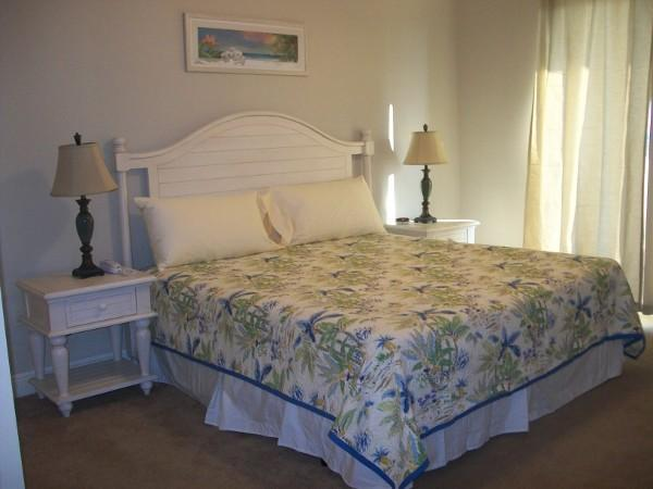 King size bed with flat screen tv and attached bathroom