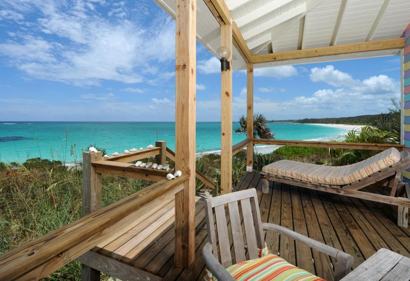Outdoor dining and lounging deck on the surfside in your one bedroom beach house for 2 people!