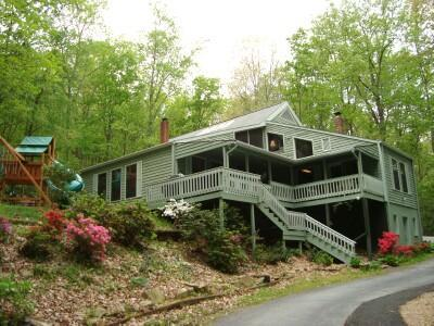 Secluded, yet right in-town, the MOUNTAIN LAUREL LODGE is nestled at the edge of an 80 acre forest