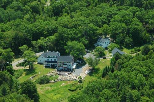 An aerial view of the estate including both buildings: Farmhouse and Cape