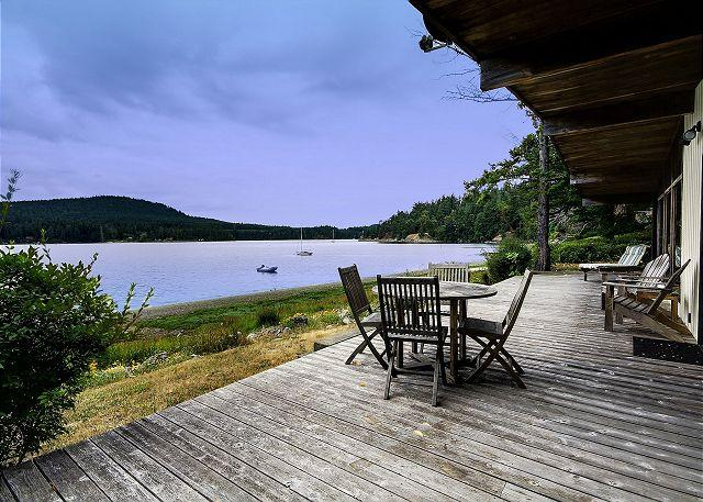 The spacious deck is easily accessed from the living space and offers expansive views of the bay