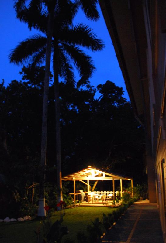 Back yard at dusk, with the gazebo ready for fun.
