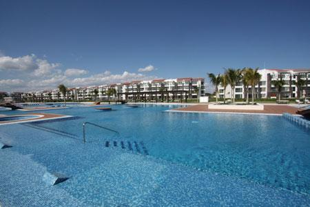 the 10,000 Sq. Ft Mareazul Pool Area - Nick Price Golf Course Beachside Condo – Cielo - Playa del Carmen - rentals