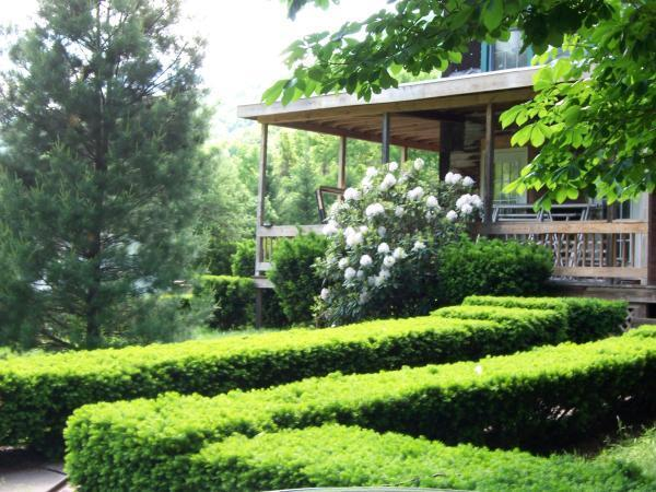 Manicured by an expert,15 acres to hike & play, decks for fun out of the sun, state land to enjoy