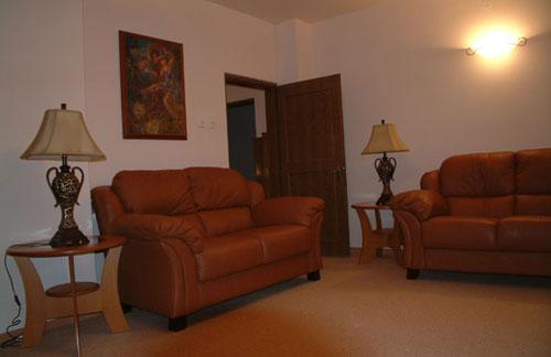 Sitting room with TV, DVD and comfortable sofas