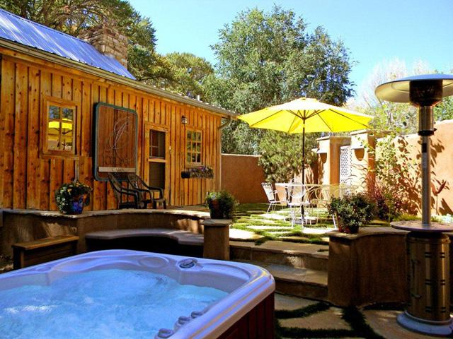 Private hot tub within private enclosed terraced patio and custom stonework