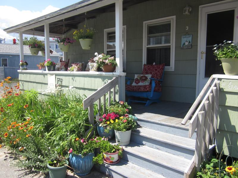 Fabulous front porch and gardens