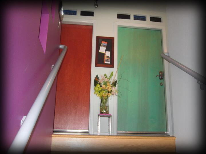 Colorful secure entry to 2nd floor studio