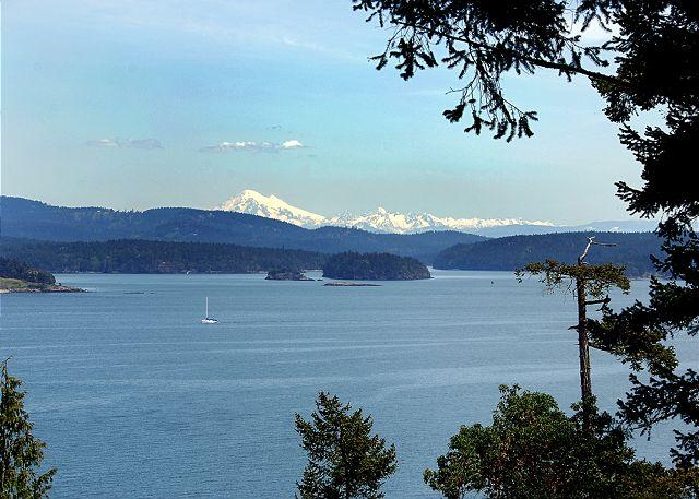 This high bank waterfront home enjoys beautiful views of Shaw, Jones and Orcas Islands and snow-covered Mt. Baker.