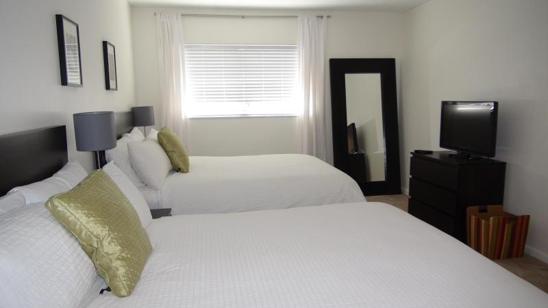 Two queen beds and 40' flat screen television in the bedroom.