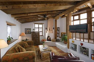 Spacious and light livng room with kiva fireplace.