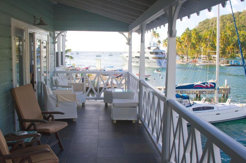 Relax on the wide balcony overlooking the marina, bay and out to sea
