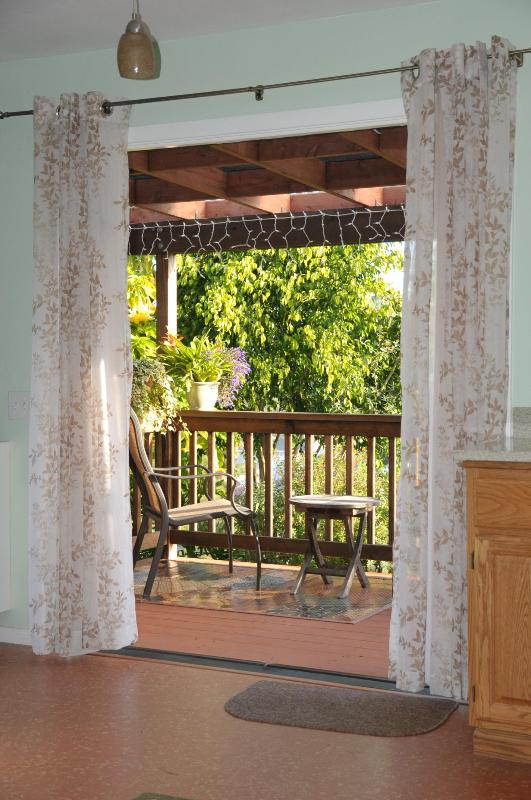 french doors opening onto private covered redwood deck