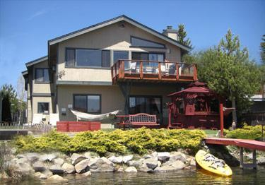 Tandem kayak on private dock with hot tub, balcony, lawn furniture, horse shoe toss & fire pit