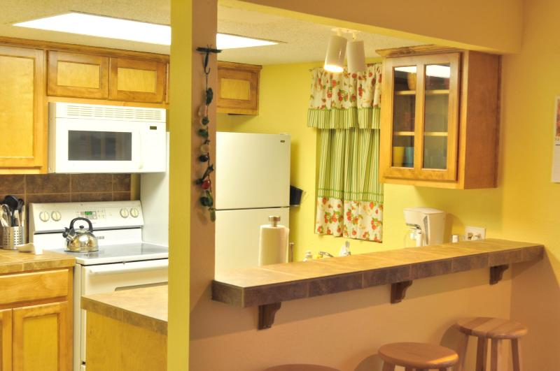 Fully furnished kitchen with breakfast bar and coffee/tea basket