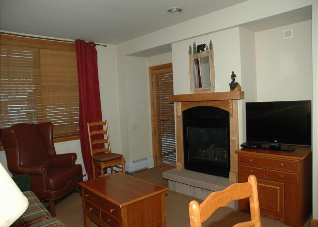Living room w/32' flat screen TV and Gas Fire Place