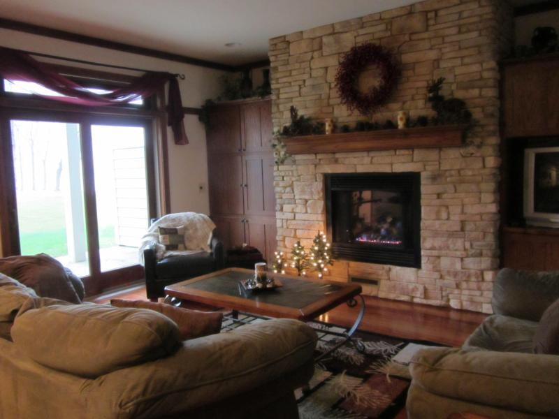Entertaining and Inviting Family Room with Patio overlooking lake