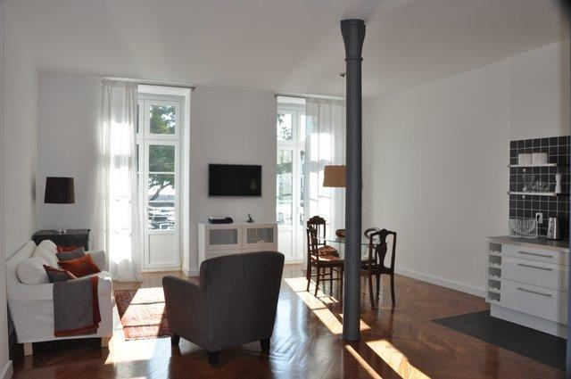 2 french windows let in lots of light. Sitting room integrates with kitchen: great for entertaining