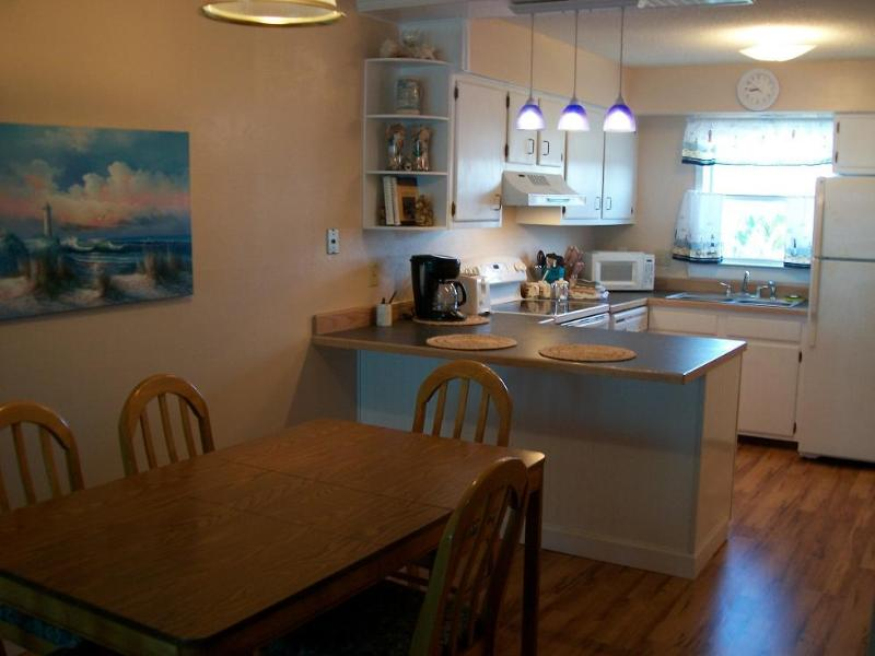 Kitchen and dining area. Table seats 6 plus 2 stools at counter. Kitchen is fully equipped for 8..