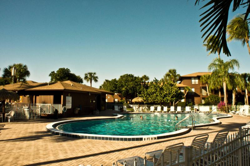 The spacious pool deck offers sun and shade.