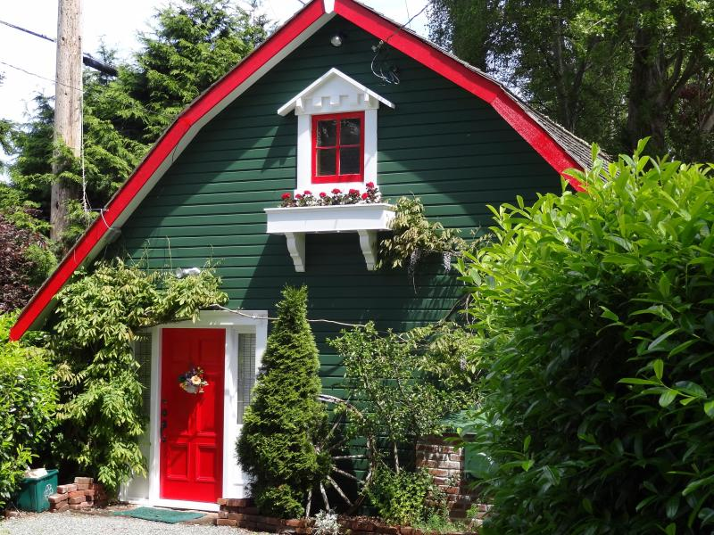 Holly red front door welcomes guests.
