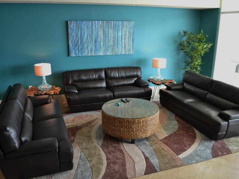 Three leather sofas in main room, overlooking Gulf - HUGE 600 sq ft room, fireplace, flat-panel TV
