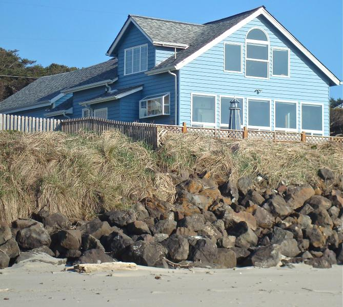 Main House as seen from sandy beach  at foot of stairs