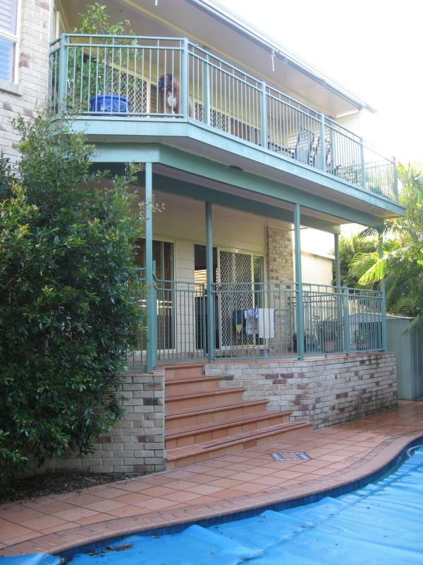 Balconies overlooking pool and oudoor barbecue area