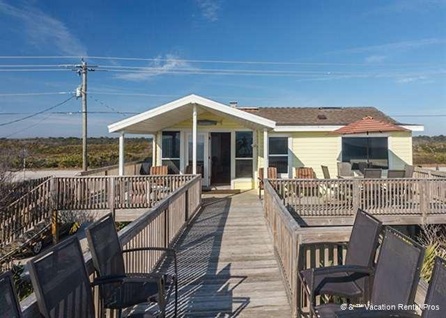 The wraparound deck leads right down to the beach!