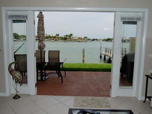Your own private patio with water just outside the french doors.