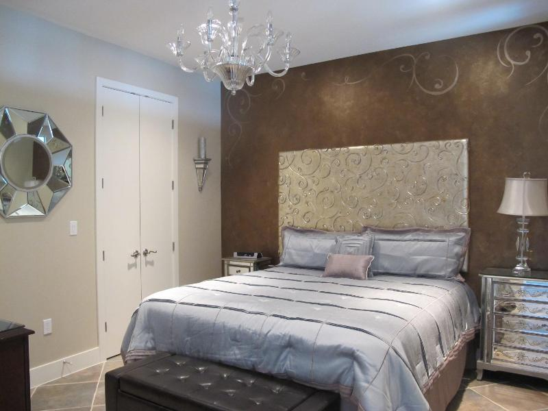 Gorgeous master bedroom with deluxe king size bed, flat screen TV and DVD