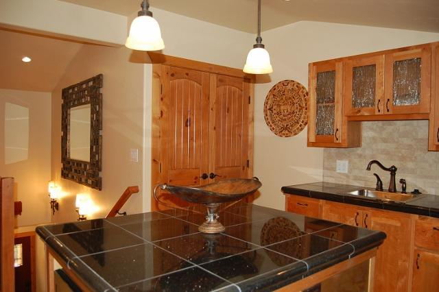 Kitchen with Knotty Cherry Cabinets and Granite countertops