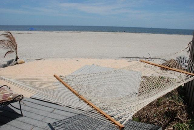 Oceanfront porch on lower level with hammock