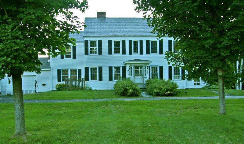 The front lawn and Historic Colonial Johnson's On Bomoseen home sited on the original1800's foundation.