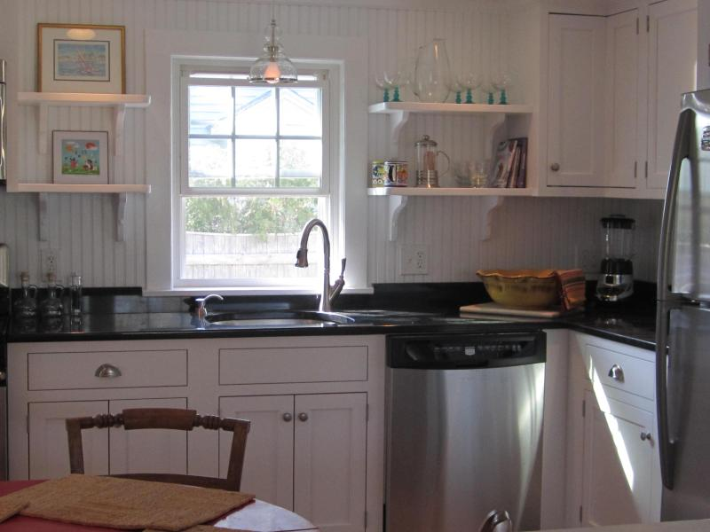 Updated cottage style kitchen with dishwasher.