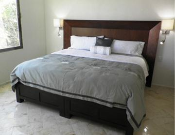 The huge master suite features a king-sized tzalam bed, feather pillows and 1,000 thread count sheets