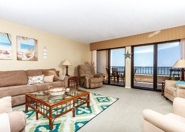 Bright, vibrant colors make this spacious Gulf-front living room