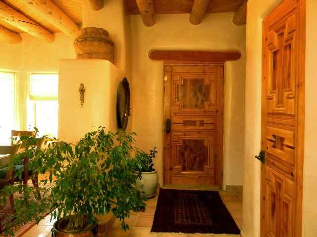 Front foyer door showing hand carved custom crafted solid wood doors throughout