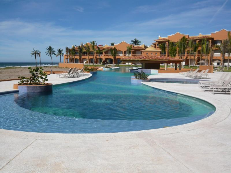 Pool on the Ocean with Condo to the right of the Pool