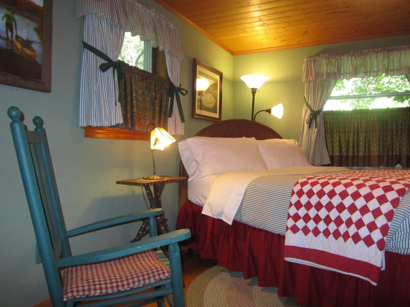 Master Bedroom with Queen Bed. Country french fabrics of sage green & brick red..