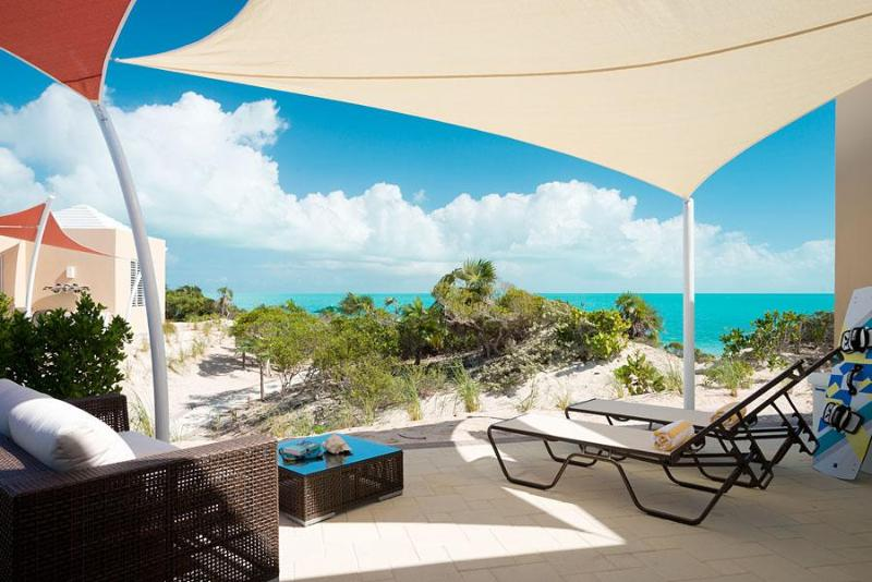 Private outdoor patio with shade sails