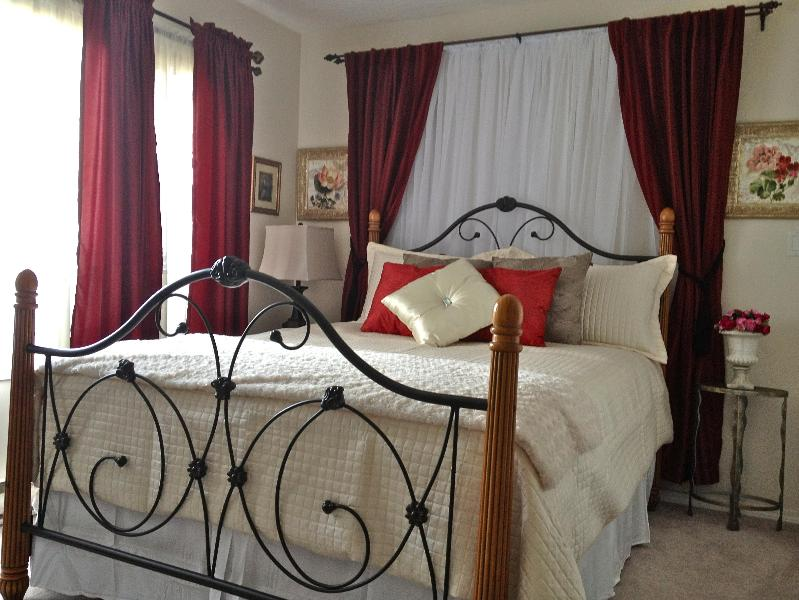 Romantic queen bed with plush duvet, and even a throw to snuggle up with in your full size suite!