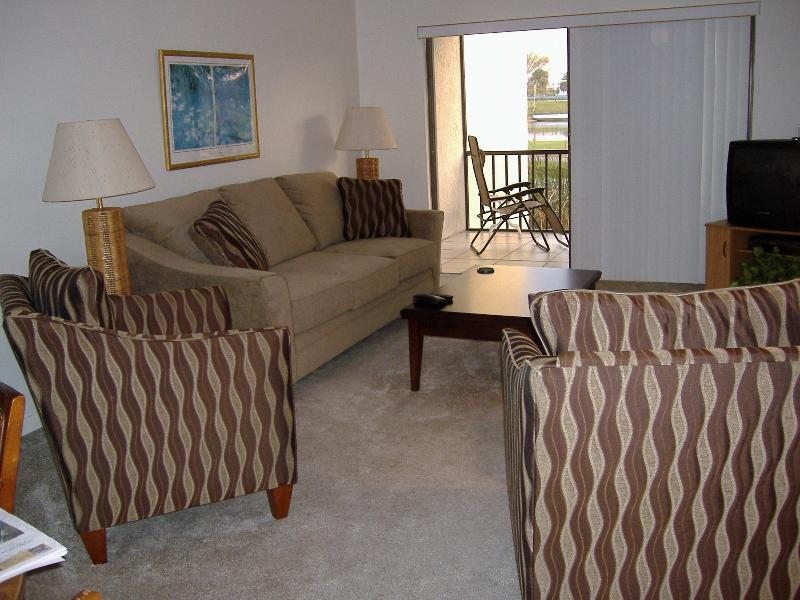 View from dining area into living room including porch