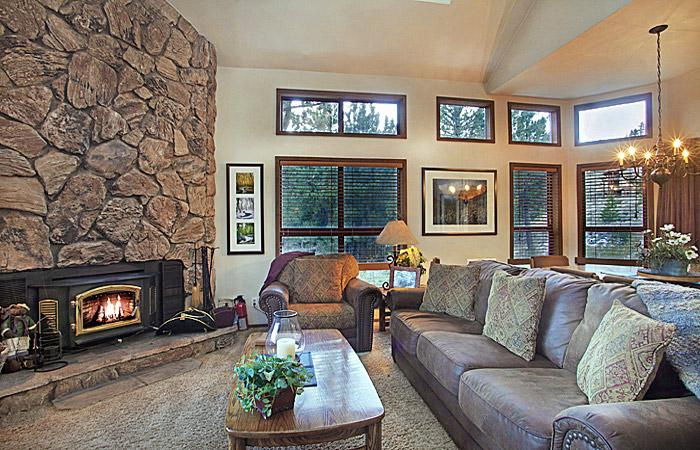 Aspen Creek #6 Living Area with Wood burning Fireplace and floor to ceiling windows