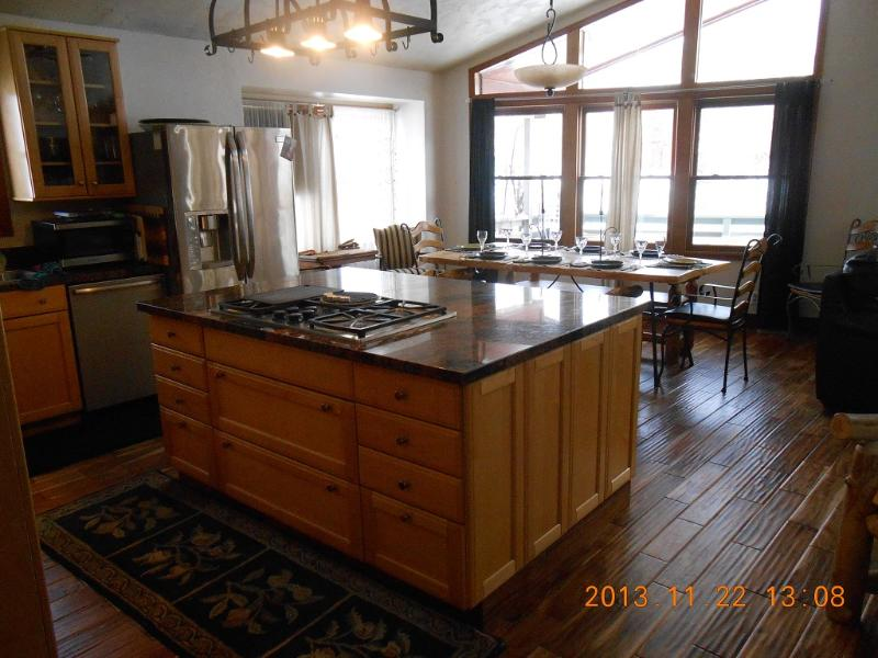 new hard wood flooring and stainless steel kitchen with double wall oven